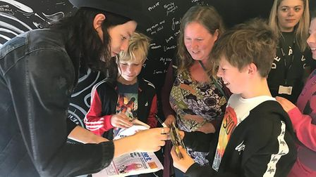 Rowan and Finn Scourfield, pictured with mum Inga, met their idol James Bay in London - and he signe