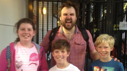Rowan and Finn with their cousin Maddie Thorogood with School of Rock actor Stephen Leask.