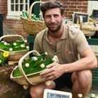 Alan North, head gardener at Audley End House with the organic apple juice made from fruit from the