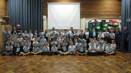 Pupils and staff at Pixmore School with the Rotary dictionaries donated by the Rotary Club of Letchw