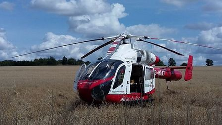 An air ambulance landed in a field in Queenswood Drive earlier today after a man fell unconscious in