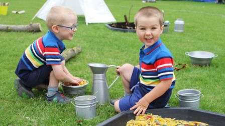 Shefford Play Day: Sid and Ted Rainbow, ages four and three, enjoy making pasta. Picture: Karyn Hadd