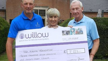 Craig Crowhurst, men's captain at Chesfield Downs Golf and Country Club, presents a cheque to Megs a
