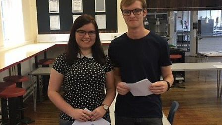 Thomas Alleyne Academy's Joanne Balharrie and Matthew Hall with their A-level results. Picture: Fran