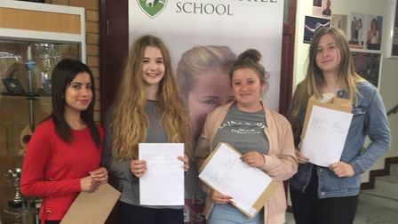 Students at Letchworth's Fearnhill School celebrate receiving their A-level results. From left to ri