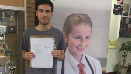 Anthony Macit, who will study maths at Warwick, with his A-level results at Letchworth's Fearnhill S