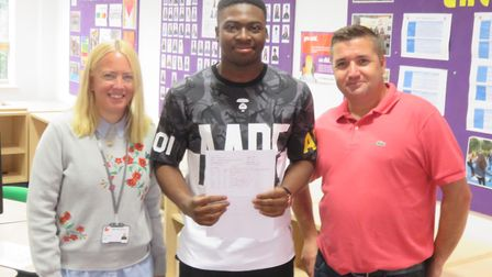 Junior Kotomah with his A-level results at Stevenage's Marriotts School, flanked by head Beth Honnor