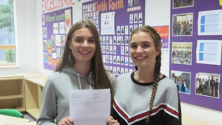 Ellen and Leigh Turner celebrate receiving their A-level results at Stevenage's Marriotts School. Pi