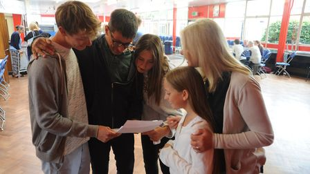 Ben Buky and family look at the GCSE results. Picture: Knights Templar School