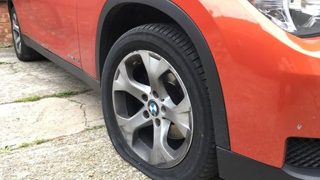 The flat tyre on Sukhi Rayat's orange BMW X1 that led to the whole ordeal. Picture: JP Asher
