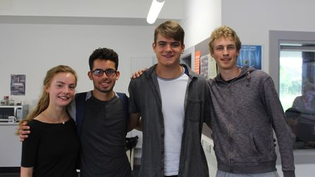 Rae-Anna Osley, Danny McConnell, Richard Oldham and Edward Wilsher celebrate receiving their A-level