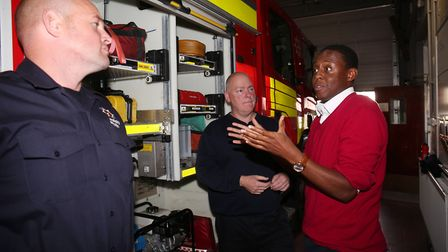 Watch commander Mark Burgess and firefighter Kev Smith show Hitchin and Harpenden MP Bim Afolami aro