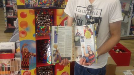 Stevenage sport stacker James Acraman shows off his entry in the 2018 Guinness World Records book. P