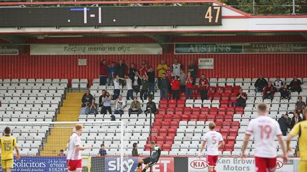 The Morecambe fans behind the Stevenage goal. Picture: Danny Loo