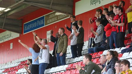 The Morecambe fans celebrate Steven Old's goal. Picture: Danny Loo