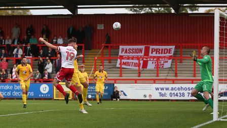 Danny Newton heads against the post after getting up well at the back post. Picture: Danny Loo