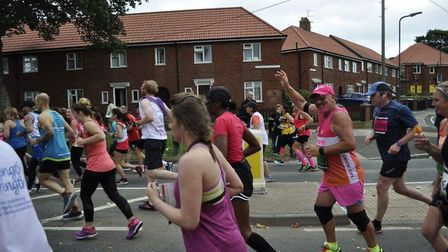 Steve Grimsley waves to a supporter during his 20th Great North Run, which he was running for Breast