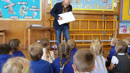 Author and illustrator James Mayhew talks to the kids at Hitchin's Purwell Primary School. Picture: