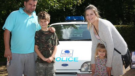 Gavin and Ben Partridge, 10, Charlotte Dawson and Kimberley Partridge, 3 with a classic tv police ca