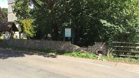 The boundary wall at St Giles Church. Picture: Herts police