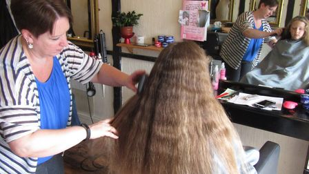 Ella Aquilina about to have her hair cut to support the Little Princess Trust. Picture: Sue Chilvers