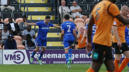 Tom Pett celebrates his goal with his team mates. Picture: Danny Loo