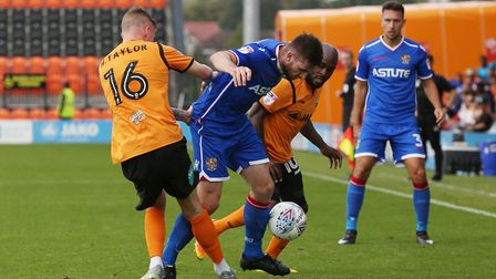 Danny Newton gets between two Barnet players. Picture: Danny Loo
