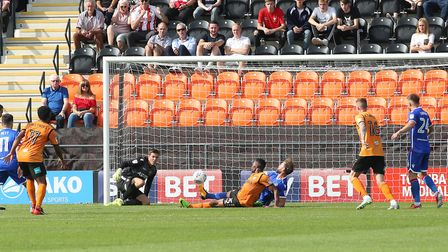 Joe Fryer looks on after a shot comes back off the post. Picture: Danny Loo
