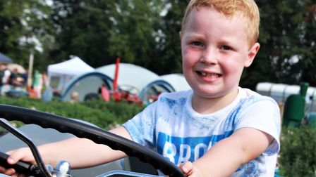 Joseph Okell, aged five, from Letchworth tries out a 1952 Ferguson Tedeo Tractor. Picture: Clive Por