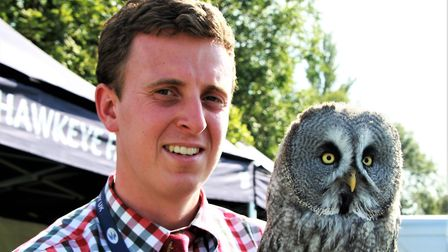 Canadian great grey owl Bluebell with falconer Alistair Lease from Hawkeye Falconry UK. Picture: Cl
