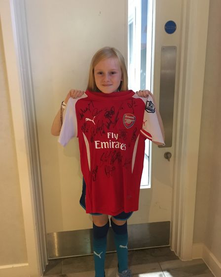Katie Harrington-Pike with a signed Arsenal shirt after the match