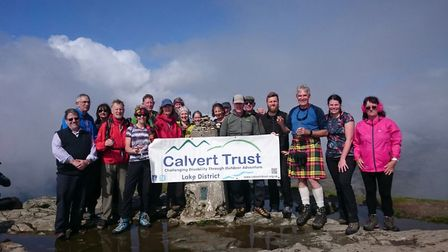 The Watson family and their companions on top of their final Munro, Ben Lomond. Picture: Celia Watso