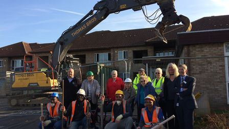 Fomrer Hamonte residents and members of the Howard Cottage team and demolition workers came to watch