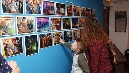Families looking at photographs of Stevenage fair at a recent exhibition at the museum