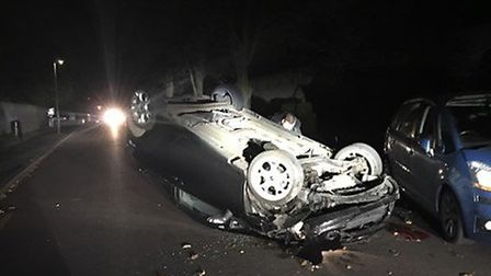 The driver fled after the car flipped on to its roof in Pixmore Avenue. Picture: Tracy Flack