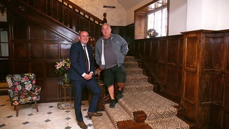 General manager Dean Thompson and maintenance manager Ian Swaine on the wooden staircase in entrance