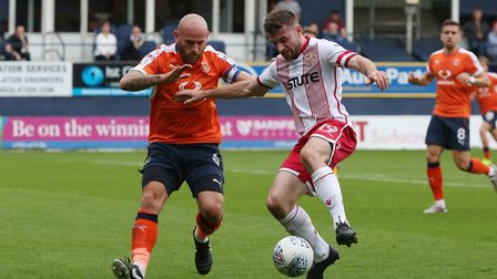 Danny Newton takes on Scott Cuthbert in the box. Picture: Danny Loo
