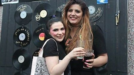 People enjoying the memory wall made up of records. Picture: Luna Louise Photography
