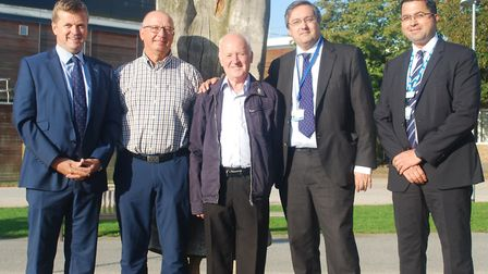 John Rouse (centre) was the urology team's first patient for prostate cancer surgery, and Arthur Sad