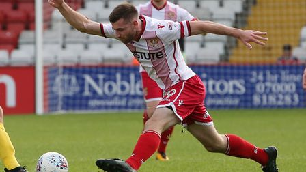 Danny Newton closes down the ball. Picture: Danny Loo