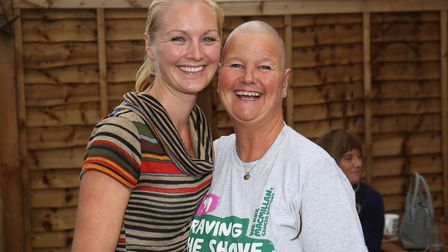 Elisabeth Rainbow with her mum Josephine Wiles after her Brave the Shave for Macmillan. Picture: Dan