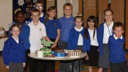 Years two, four and six pupils with some of the cakes at Roebuck Academy baked for the Macmillan Cof