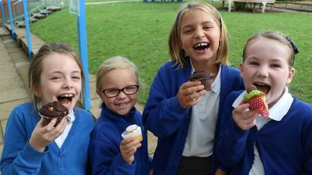 Purwell School students enjoying cake at their break time coffee morning. Picture: Stella Barnes