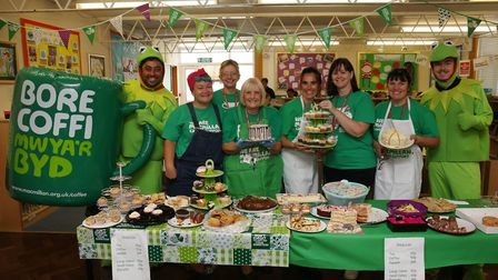Staff at Broom Barns Community Primary School sell cakes for the Macmillan Coffee morning. Picture: