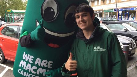 Budgens staff member Charlie Crichton with Muggy at the Circle Cafe/Budgens coffee morning. Picture:
