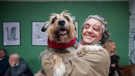 Garden City Brewery regular Rocco the dog, with his owner. Picture: Paul Louis Archer