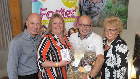 Diane Humberstone and Richard Bollen, of Stotfold, receive their Fabulous Foster Carers Award from C