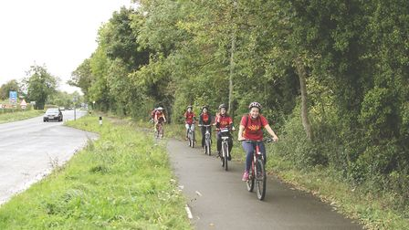 The team start the last leg of the journey along the A10 cycle path. Picture: HKBJ