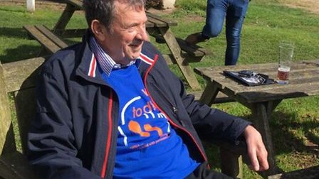 Pete Jackson wearing the blue, orange and white of the Walks to D'Feet MND initiative during one of