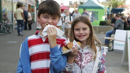 James Mercer, 10, and Iona Mercer, 8, enjoy the food at the festival. Picture: Karyn Haddon
